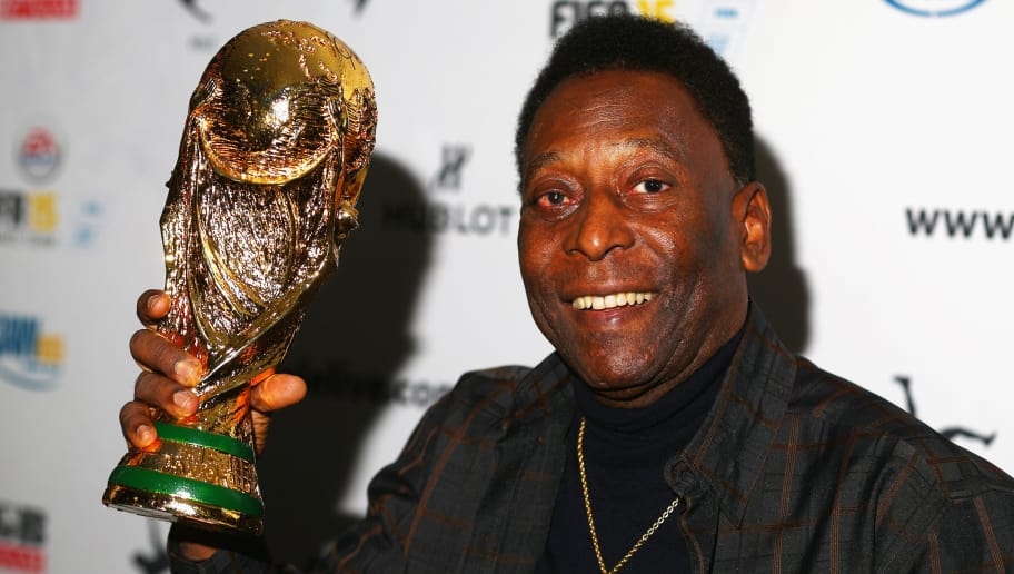 MELBOURNE, AUSTRALIA - MARCH 26: Pele holds a replica Wolrd Cup trophy during a press conference at The Peninsula on March 26, 2015 in Melbourne, Australia.  (Photo by Robert Cianflone/Getty Images)