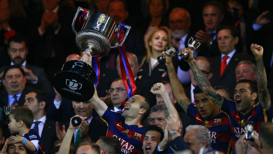 MADRID, SPAIN - MAY 22: captain Andres Iniesta of FC Barcelona holds the trophy in celebration ahead King Felipe VI of Spain during the Copa del Rey Final match between FC Barcelona and Sevilla FC at Vicente Calderon Stadium on May 22, 2016 in Madrid, Spain. (Photo by Gonzalo Arroyo Moreno/Getty Images)