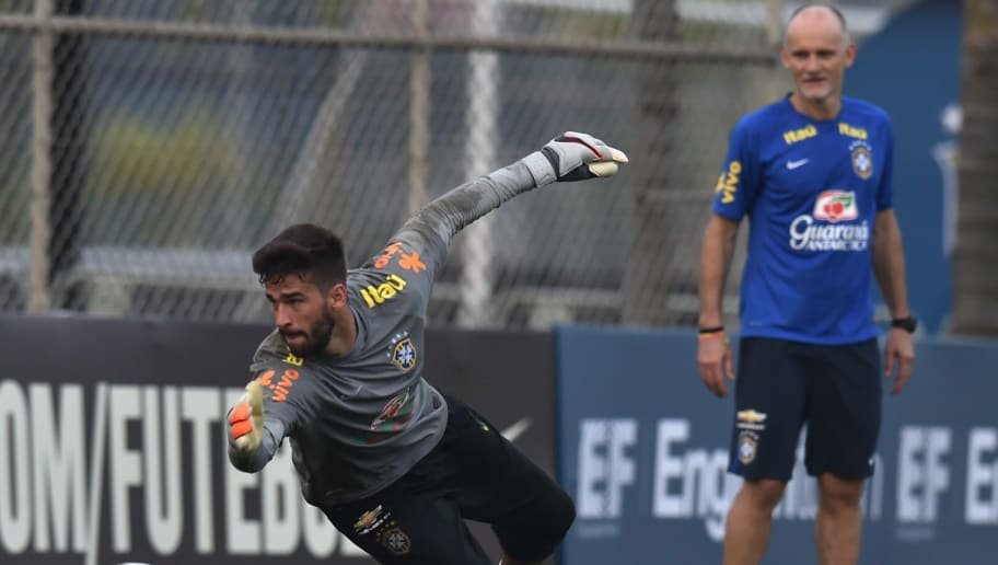 Brazil's goalkeeper Alisson takes part in a training session at the Corinthians training center in Sao Paulo, Brazil, on November 10, 2015. Brazil will face Argentina on November 12 in a FIFA World Cup Russia 2018 qualifier match. AFP PHOTO / Nelson ALMEIDA        (Photo credit should read NELSON ALMEIDA/AFP/Getty Images)