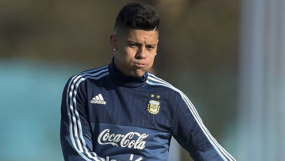 Argentinian defender Marcos Rojo kicks the ball during a training session in Ezeiza, Buenos Aires, on May 24, 2016, in preparation for the Copa America Centenario in the United States. / AFP / EITAN ABRAMOVICH        (Photo credit should read EITAN ABRAMOVICH/AFP/Getty Images)