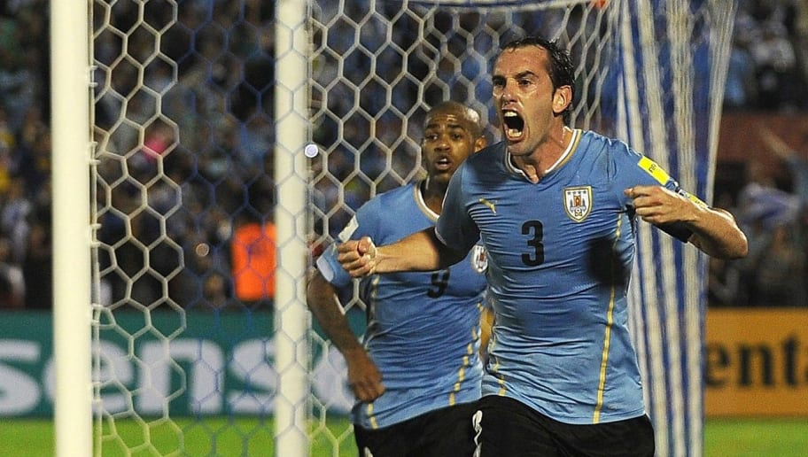 Uruguay's Diego Godin celebrates after scoring against Chile during their Russia 2018 FIFA World Cup South American Qualifiers football match, in Montevideo, on November 17, 2015.   AFP PHOTO / MIGUEL ROJO        (Photo credit should read MIGUEL ROJO/AFP/Getty Images)