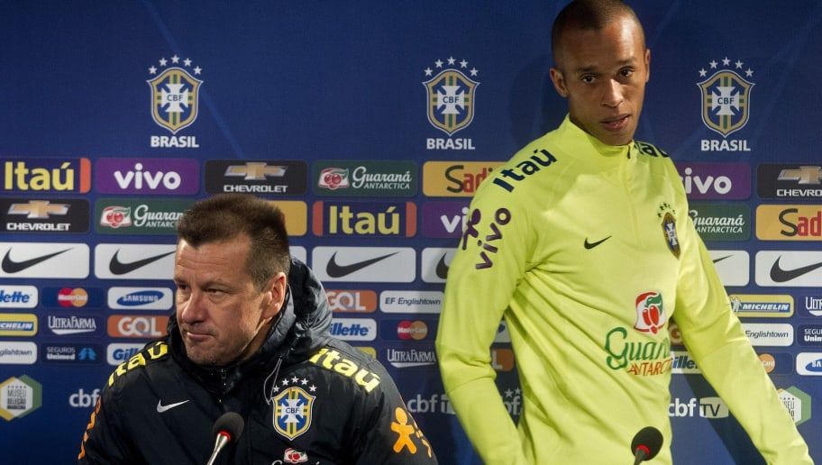 Brazil's national team coach Dunga (L) and footballer Miranda (R) attend a press conference at San Carlos de Apoquindo stadium in Santiago, Chile, on October 7, 2015. Brazil will face Chile on October 8 for a Russia 2018 FIFA World Cup qualifying match. AFP PHOTO/CLAUDIO REYES        (Photo credit should read Claudio Reyes/AFP/Getty Images)