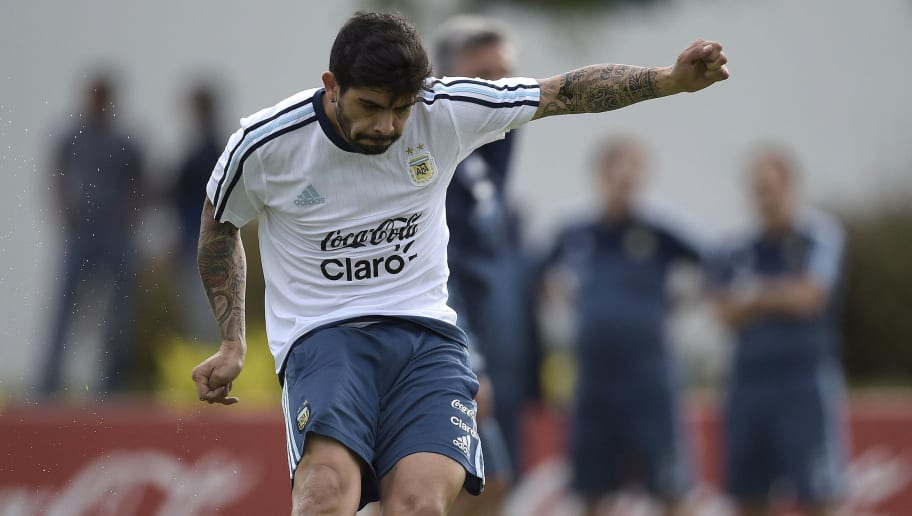 Argentina's midfielder Ever Banega strikes the ball during a training session in Ezeiza, Buenos Aires on March 21, 2016 ahead of a 2018 FIFA World Cup Russia South American qualifier football match against Chile to be held in Santiago on March 24. AFP PHOTO / JUAN MABROMATA / AFP / JUAN MABROMATA        (Photo credit should read JUAN MABROMATA/AFP/Getty Images)