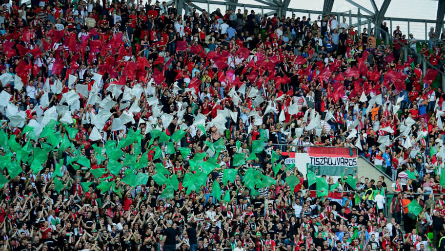 Hungary's fans cher their national team with Hungarian tricolors during a friendly football match between Hungary and Ivory Coast on May 20, 2016 at Groupama Arena of Budapest. / AFP / ATTILA KISBENEDEK        (Photo credit should read ATTILA KISBENEDEK/AFP/Getty Images)