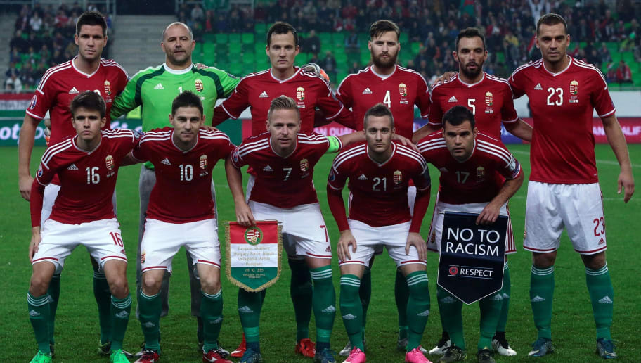 Hungary's national team players (1st row down, L-R) midfielder Adam Nagy, midfielder Zoltan Gera, midfielder, captain Balazs Dzsudzsak, midfielder Adam Bodi and forward Nemanja Nikolic , (2nd row over, Lt-R) defender Richard Guzmics, goalkeeper Gabor Kiraly, midfielder Daniel Tozser, defender Tamas Kadar, midfielder Attila Filola and defender Roland Juhasz pose for a team photo prior to the UEFA 2016 European Championship qualifying round Group F football match Hungary vs Faroe Islands at the Groupama Arena  in Budapest on October 8, 2015.  AFP PHOTO / FERENC ISZA        (Photo credit should read FERENC ISZA/AFP/Getty Images)