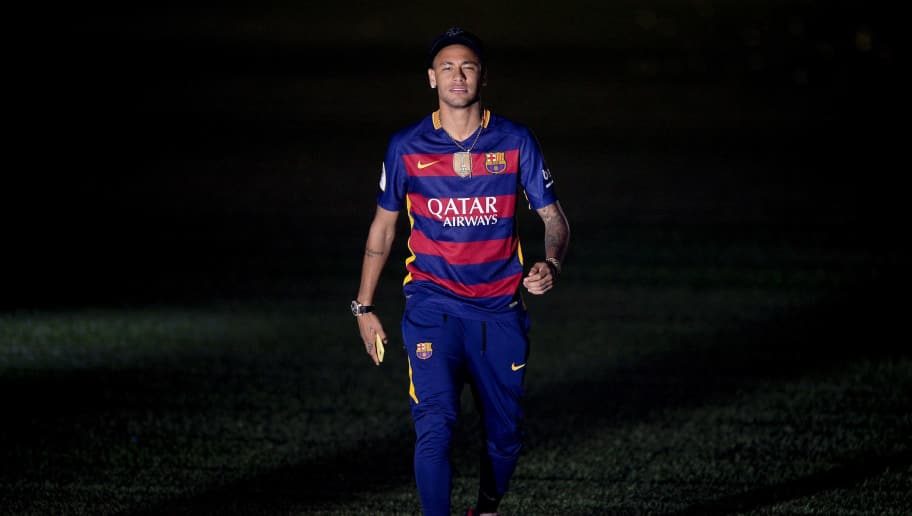 Barcelona's Brazilian forward Neymar walks on the pitch during celebrations at the Camp Nou stadium in Barcelona on May 23, 2016 following their Spanish 'Copa del Rey' (King's Cup) final football match 2-0 victory over Sevilla FC yesterday also marking the club's 28th Copa del Rey win and the 24th Spanish Liga title. / AFP / JOSEP LAGO        (Photo credit should read JOSEP LAGO/AFP/Getty Images)