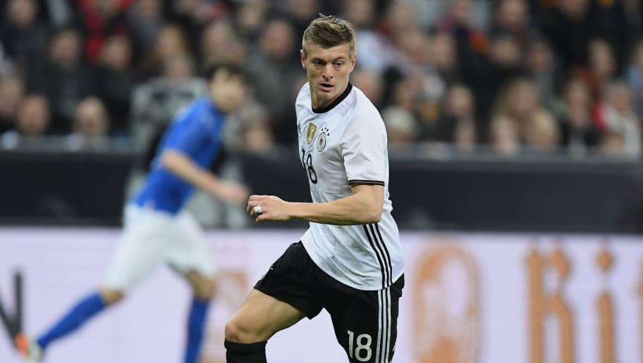 MUNICH, GERMANY - MARCH 29:  Toni Kroos of Germany controls the ball during the International Friendly match between Germany and Italy at Allianz Arena on March 29, 2016 in Munich, Germany.  (Photo by Matthias Hangst/Bongarts/Getty Images)