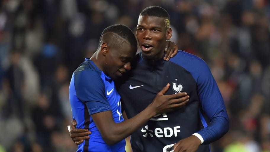 France's defender Paul Pogba (R) and France's midfielder Blaise Matuidi celebrate after winning the friendly football match between France and Cameroon, at the Beaujoire Stadium in Nantes, western France, on May 30, 2016. / AFP / LOIC VENANCE        (Photo credit should read LOIC VENANCE/AFP/Getty Images)