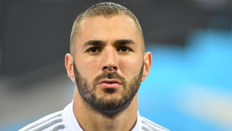 Real Madrid's French forward Karim Benzema looks on before the UEFA Champions League final football match between Real Madrid and Atletico Madrid at San Siro Stadium in Milan, on May 28, 2016. / AFP / GERARD JULIEN        (Photo credit should read GERARD JULIEN/AFP/Getty Images)