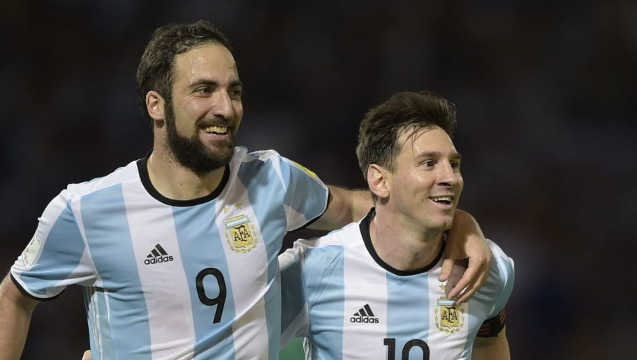 Argentina's Gonzalo Higuain (L) and Lionel Messi celebrate after teammate Gabriel Mercado scored against Bolivia during their Russia 2018 FIFA World Cup South American Qualifiers' football match in Cordoba, Argentina, on March 29, 2016.   AFP PHOTO / JUAN MABROMATA / AFP / JUAN MABROMATA        (Photo credit should read JUAN MABROMATA/AFP/Getty Images)