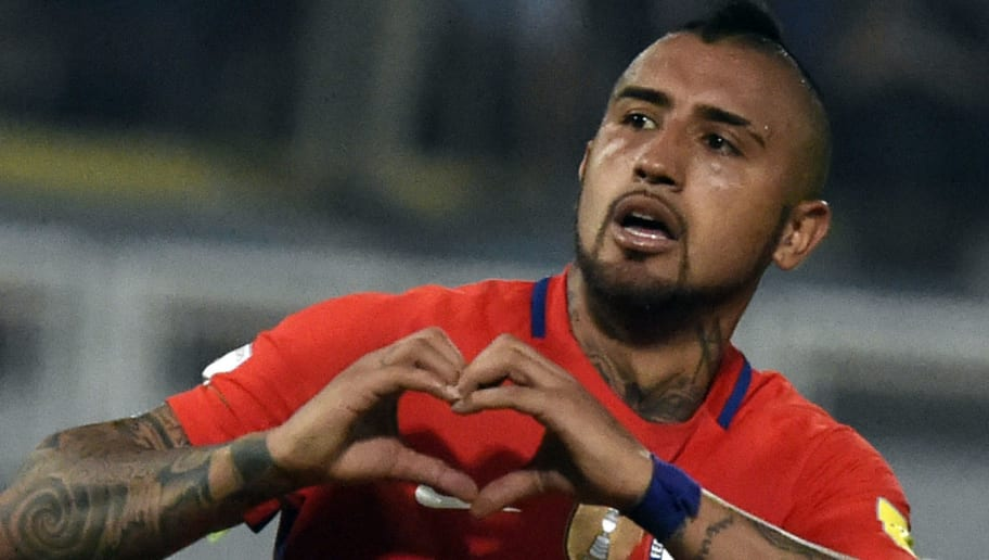 Chile's Arturo Vidal celebrates after scoring against Venezuela during their Russia 2018 FIFA World Cup South American Qualifiers' football match, in Barinas, Venezuela, on March 29, 2016.    AFP PHOTO / JUAN BARRETO / AFP / JUAN BARRETO        (Photo credit should read JUAN BARRETO/AFP/Getty Images)