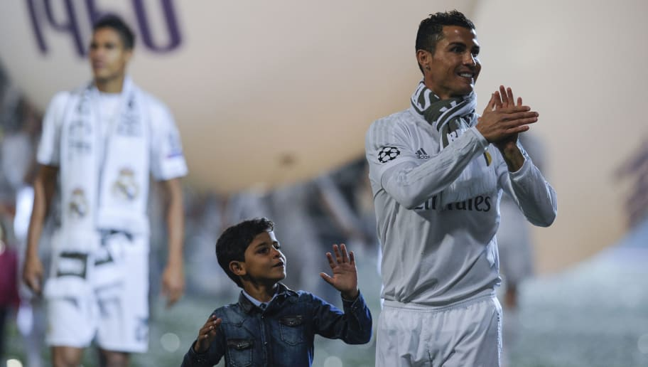 Real Madrid's Portuguese forward Cristiano Ronaldo walks with his son during celebrations for their 11th UEFA Champions Cup at the Santiago Bernabeu stadium in Madrid on May 29, 2016, a day after winning the UEFA Champions League final foobtall match between Real Madrid CF, Club Atletico de Madrid held in Milan, Italy on May 28, 2016.  / AFP / PEDRO ARMESTRE        (Photo credit should read PEDRO ARMESTRE/AFP/Getty Images)