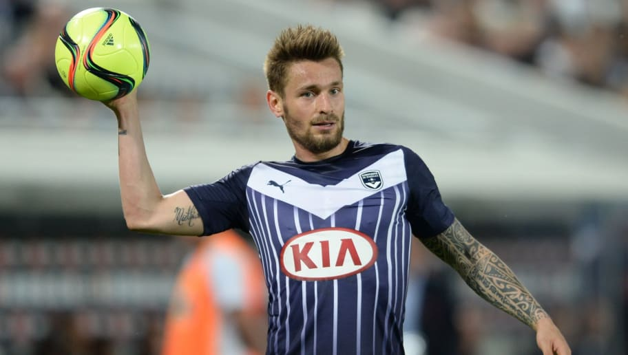 Bordeaux' French defender Mathieu Debuchy holds the ball during the French Ligue 1 football  match between Bordeaux and Lorient on May 7, 2016 at the Matmut Atlantique stadium in Bordeaux, southwestern France. AFP PHOTO / NICOLAS TUCAT / AFP / NICOLAS TUCAT        (Photo credit should read NICOLAS TUCAT/AFP/Getty Images)
