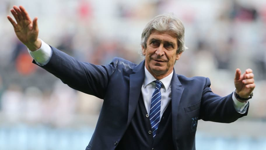 Manchester City's Chilean manager Manuel Pellegrini waves to supporters after the English Premier League football match between Swansea City and Manchester City at The Liberty Stadium in Swansea, south Wales on May 15, 2016. The game finished 1-1. / AFP / GEOFF CADDICK / RESTRICTED TO EDITORIAL USE. No use with unauthorized audio, video, data, fixture lists, club/league logos or 'live' services. Online in-match use limited to 75 images, no video emulation. No use in betting, games or single club/league/player publications.  /         (Photo credit should read GEOFF CADDICK/AFP/Getty Images)