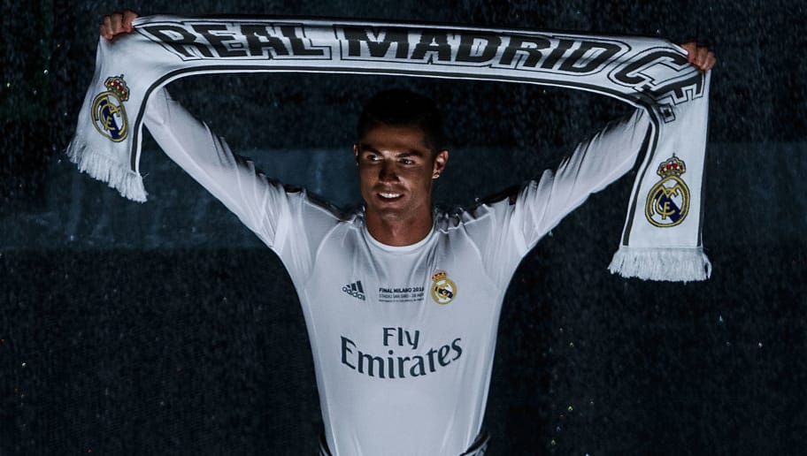 MADRID, SPAIN - MAY 29: Cristiano Ronaldo of Real Madrid CF holds a scarf as he enters the pitch during Real Madrid CF team celebration at Santiago Bernabeu Stadium the day after winning the UEFA Champions League Final match against Club Atletico de Madrid on May 29, 2016 in Madrid, Spain. Real Madrid CF is the only European football team with 11 European Cups (Photo by Gonzalo Arroyo Moreno/Getty Images)
