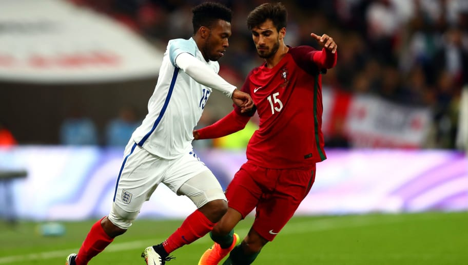 LONDON, ENGLAND - JUNE 02:  Daniel Sturridge of England takes on Andre Gomes of Portugal during the international friendly match between England and Portugal at Wembley Stadium on June 2, 2016 in London, England.  (Photo by Clive Rose/Getty Images)
