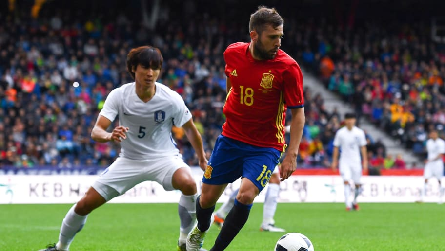 SALZBURG, AUSTRIA - JUNE 01:  Jordi Alba of Spain competes for the ball with Taehwi Kwak of Korea during an international friendly match between Spain and Korea at the Red Bull Arena stadium on June 1, 2016 in Salzburg, Austria.  (Photo by David Ramos/Getty Images)