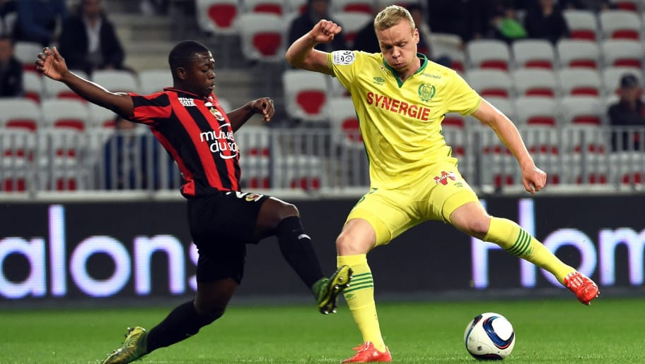 Nice's French midfielder Nampalys Mendy (L) vies with Nantes' Icelandic forward Kolbeinn Sigthorsson (R) during the French Ligue 1 football match between Nice and Nantes, on November 4, 2015 at the Allianz Riviera Stadium in Nice, southern France.. AFP PHOTO / ANNE-CHRISTINE POUJOULAT        (Photo credit should read ANNE-CHRISTINE POUJOULAT/AFP/Getty Images)
