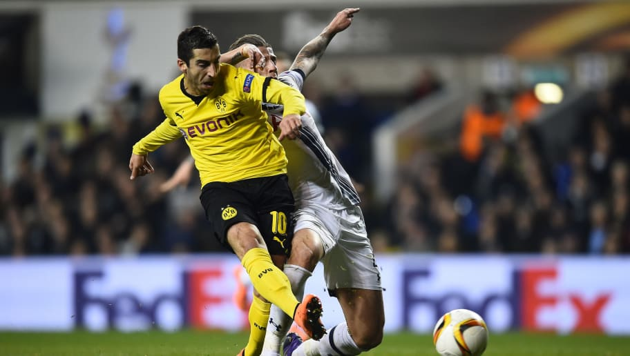 LONDON, ENGLAND - MARCH 17:  Henrikh Mkhitaryan of Borussia Dortmund is challenged by Toby Alderweireld of Tottenham Hotspur during the UEFA Europa League round of 16, second leg match between Tottenham Hotspur and Borussia Dortmund at White Hart Lane on March 17, 2016 in London, England.  (Photo by Laurence Griffiths/Getty Images)
