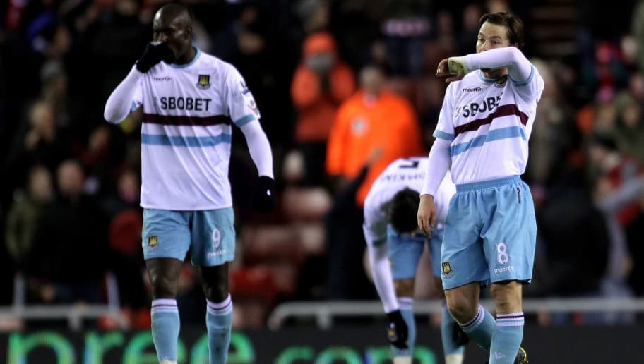 SUNDERLAND, ENGLAND - DECEMBER 05:  Scott Parker (R) and Carlton Cole of West Ham United retreat to their own half after conceding the opening goal during the Barclays Premier League match between Sunderland and West Ham United at the Stadium of Light on December 5, 2010 in Sunderland, England. (Photo by Alex Livesey/Getty Images)