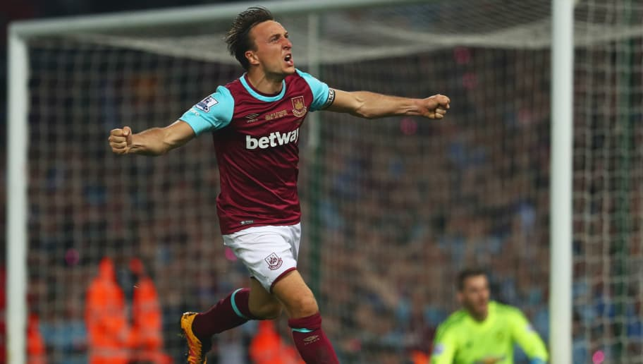 LONDON, ENGLAND - MAY 10:  Mark Noble of West Ham United celebrates as Michail Antonio of West Ham United scores their second and equalising goal during the Barclays Premier League match between West Ham United and Manchester United at the Boleyn Ground on May 10, 2016 in London, England. West Ham United are playing their last ever home match at the Boleyn Ground after their 112 year stay at the stadium. The Hammers will move to the Olympic Stadium for the 2016-17 season.  (Photo by Julian Finney/Getty Images)