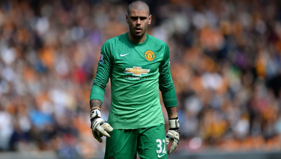 Manchester United's Spanish goalkeeper Victor Valdes plays during the English Premier League football match between Hull City and Manchester United at the KC Stadium in Kingston upon Hull, north east England on May 24, 2015.  AFP PHOTO / OLI SCARFF  RESTRICTED TO EDITORIAL USE. NO USE WITH UNAUTHORIZED AUDIO, VIDEO, DATA, FIXTURE LISTS, CLUB/LEAGUE LOGOS OR LIVE SERVICES. ONLINE IN-MATCH USE LIMITED TO 45 IMAGES, NO VIDEO EMULATION. NO USE IN BETTING, GAMES OR SINGLE CLUB/LEAGUE/PLAYER PUBLICATIONS.        (Photo credit should read OLI SCARFF/AFP/Getty Images)