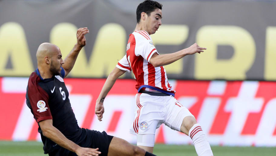 PHILADELPHIA, PA - JUNE 11:  Miguel Almiron #17 of Paraguay tries to keep the ball as John Brooks #6 of United States slides in the first half during the Copa America Centenario Group C match at Lincoln Financial Field on June 11, 2016 in Philadelphia, Pennsylvania.  (Photo by Elsa/Getty Images)