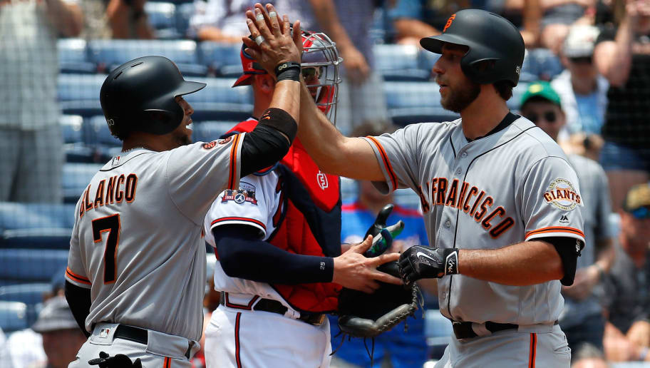 ATLANTA, GA - JUNE 02:  Madison Bumgarner #40 of the San Francisco Giants reacts after hitting a two-run homer in the fifth inning against the Atlanta Braves that also scored Gregor Blanco #7 at Turner Field on June 2, 2016 in Atlanta, Georgia.  (Photo by Kevin C. Cox/Getty Images)
