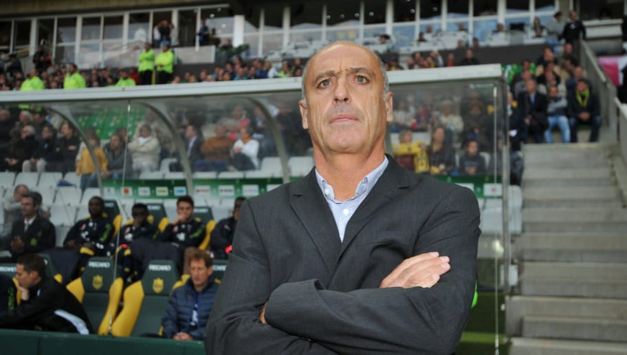 Sochaux French coach Eric Hely looks on before the French L1 football match between Nantes and Sochaux on September 14, 2013, at the La Beaujoire stadium in Nantes, western France. AFP PHOTO / FRANK PERRY        (Photo credit should read FRANK PERRY/AFP/Getty Images)