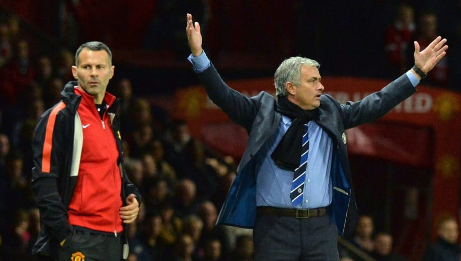 Chelsea's Portuguese manager Jose Mourinho (R) gestures as Manchester United's Welsh assistant manager Ryan Giggs looks on during the English Premier League football match between Manchester United and Chelsea at Old Trafford in Manchester, north west England, on October 26, 2014.  AFP PHOTO / PAUL ELLIS   RESTRICTED TO EDITORIAL USE. No use with unauthorized audio, video, data, fixture lists, club/league logos or live services. Online in-match use limited to 45 images, no video emulation. No use in betting, games or single club/league/player publications.        (Photo credit should read PAUL ELLIS/AFP/Getty Images)