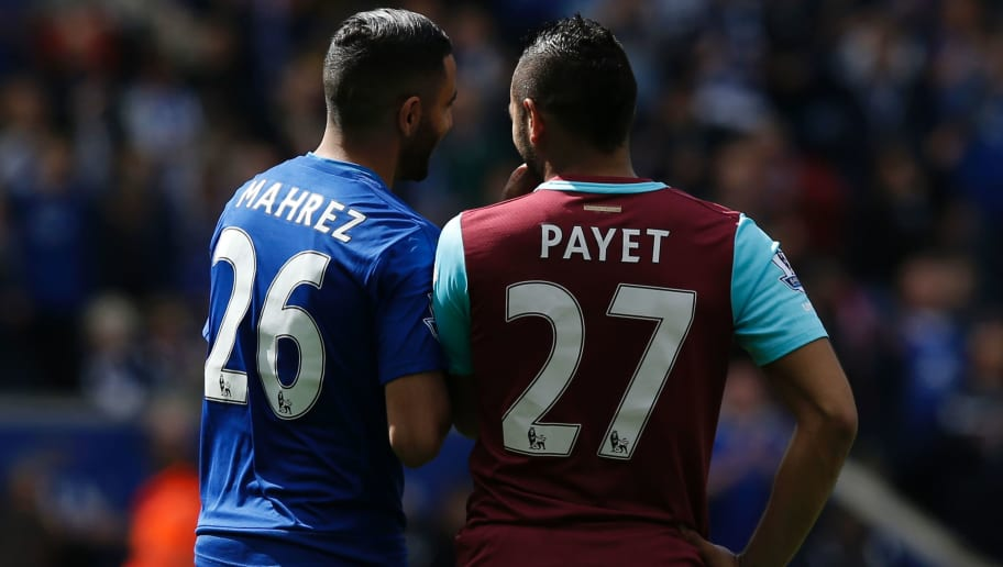 Leicester City's Algerian midfielder Riyad Mahrez (L) talks with West Ham United's French midfielder Dimitri Payet (R) before the kick off of the English Premier League football match between Leicester City and West Ham United at King Power Stadium in Leicester, central England on April 17, 2016. / AFP / ADRIAN DENNIS / RESTRICTED TO EDITORIAL USE. No use with unauthorized audio, video, data, fixture lists, club/league logos or 'live' services. Online in-match use limited to 75 images, no video emulation. No use in betting, games or single club/league/player publications.  /         (Photo credit should read ADRIAN DENNIS/AFP/Getty Images)
