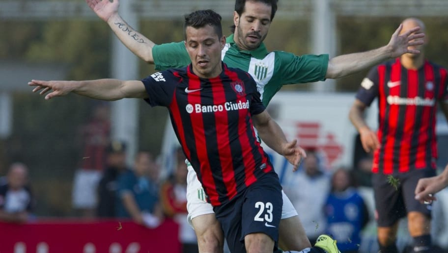 San Lorenzo's midfielder Sebastian Blanco (front) vies for the ball with Banfield's midfielder Matias Abelairas during their Argentina First Division football match at the Nuevo Gasometro stadium, in Buenos Aires, on August 30, 2015. AFP PHOTO / ALEJANDRO PAGNI        (Photo credit should read ALEJANDRO PAGNI/AFP/Getty Images)