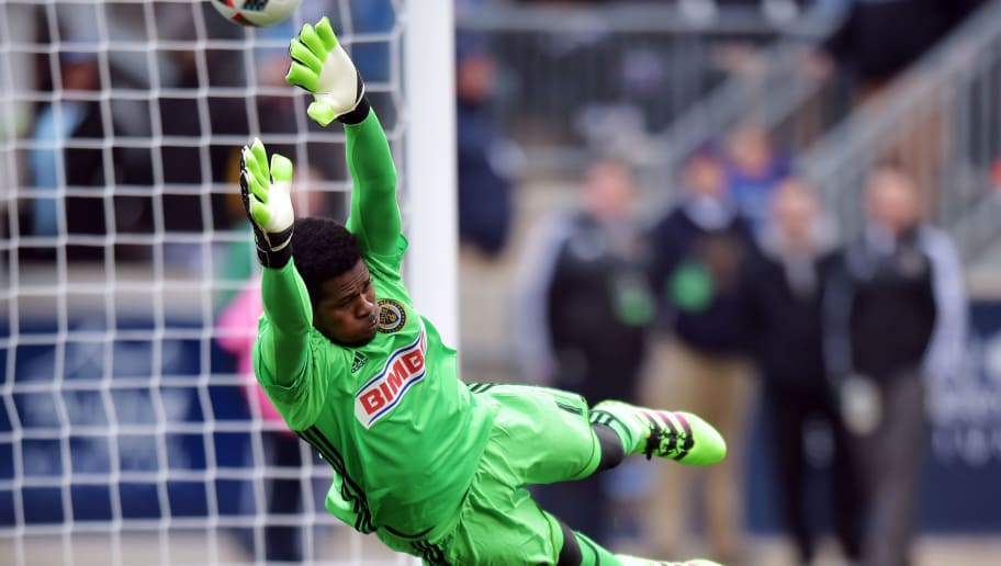 CHESTER, PA - MARCH 20: Goalkeeper Andre Blake #1 of Philadelphia Union dives to make a save as the ball get past him and bounces off the post against the New England Revolution at Talen Energy Stadium on March 20, 2016 in Chester, Pennsylvania. (Photo by Drew Hallowell/Getty Images)