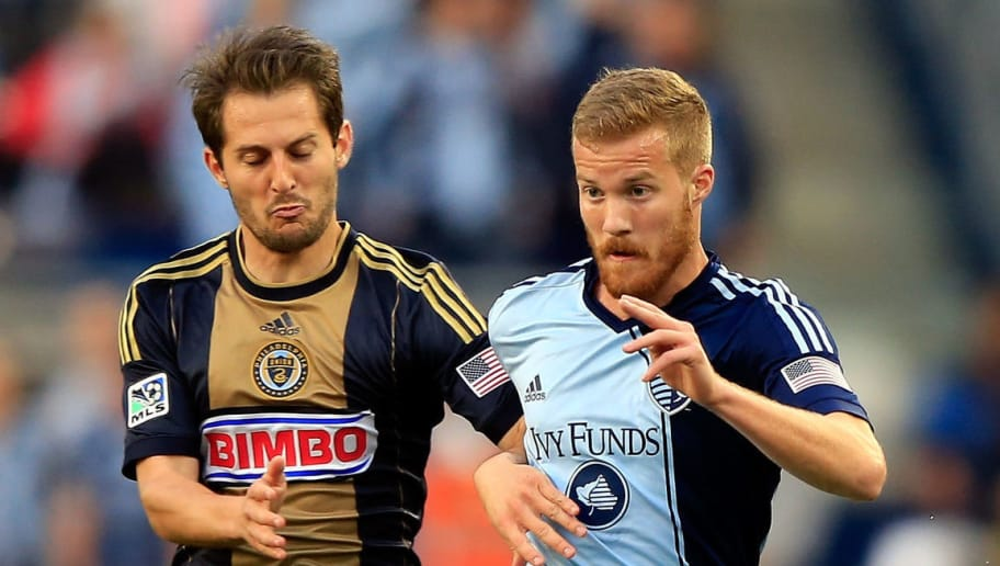 KANSAS CITY, KS - MAY 14:  Vincent Nogueira #5 of Philadelphia Union battles Oriol Rosell #20 of Sporting KC for the ball during the game at Sporting Park on May 14, 2014 in Kansas City, Kansas.  (Photo by Jamie Squire/Getty Images)