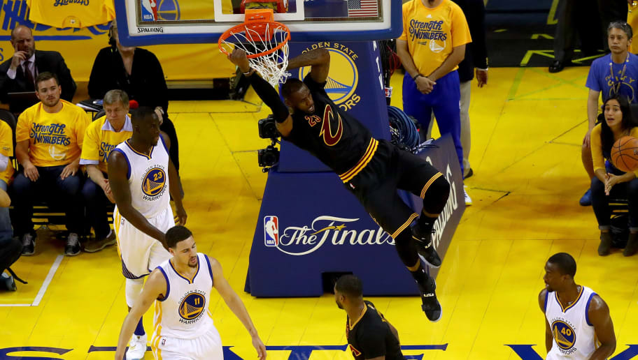 OAKLAND, CA - JUNE 19:  LeBron James #23 of the Cleveland Cavaliers dunks the ball against the Golden State Warriors in Game 7 of the 2016 NBA Finals at ORACLE Arena on June 19, 2016 in Oakland, California. NOTE TO USER: User expressly acknowledges and agrees that, by downloading and or using this photograph, User is consenting to the terms and conditions of the Getty Images License Agreement.  (Photo by Ezra Shaw/Getty Images)