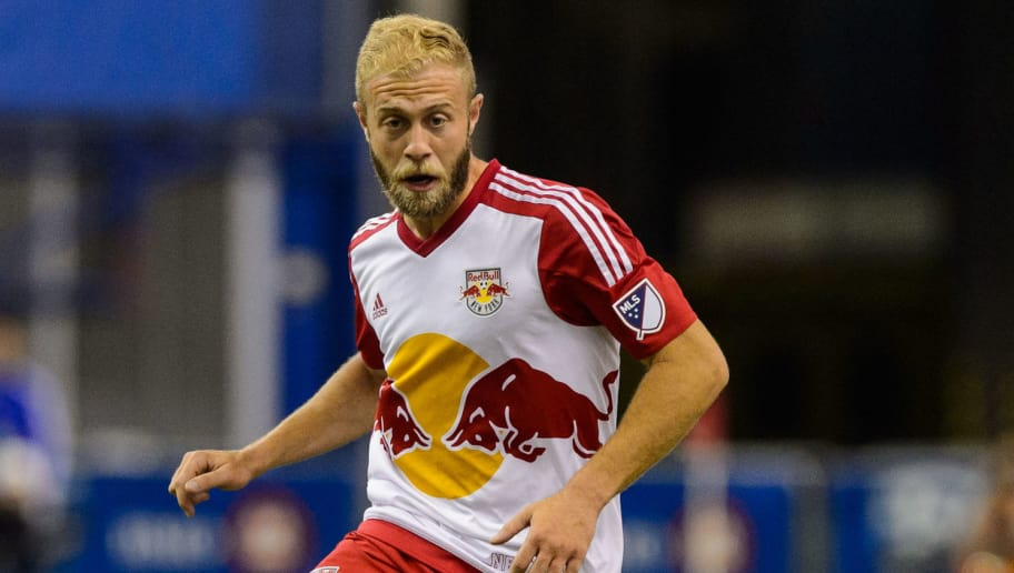 MONTREAL, QC - MARCH 12:  Mike Grella #13 of the New York Red Bulls plays the ball during the MLS game against the Montreal Impact at the Olympic Stadium on March 12, 2016 in Montreal, Quebec, Canada.  The Montreal Impact defeated the New York Red Bulls 3-0.  (Photo by Minas Panagiotakis/Getty Images)