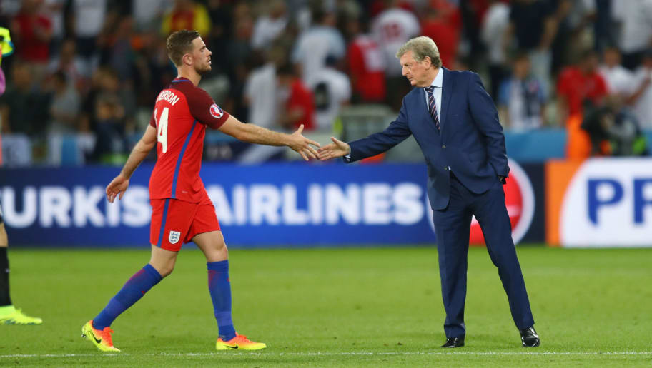 SAINT-ETIENNE, FRANCE - JUNE 20:  Manager Roy Hodgson shakes hands with Jordan Henderson after their scoreless draw in the UEFA EURO 2016 Group B match between Slovakia and England at Stade Geoffroy-Guichard on June 20, 2016 in Saint-Etienne, France.  (Photo by Julian Finney/Getty Images)