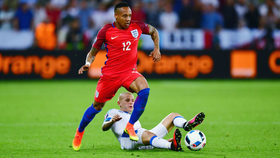 SAINT-ETIENNE, FRANCE - JUNE 20: Nathaniel Clyne of England is tackled by Vladimir Weiss of Slovakia during the UEFA EURO 2016 Group B match between Slovakia and England at Stade Geoffroy-Guichard on June 20, 2016 in Saint-Etienne, France.  (Photo by Dan Mullan/Getty Images)