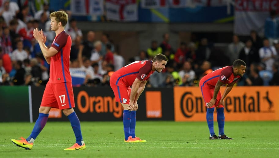 England's midfielder Eric Dier (L), England's midfielder Jordan Henderson and England's defender Ryan Bertrand react following their 0-0 draw during the Euro 2016 group B football match between Slovakia and England at the Geoffroy-Guichard stadium in Saint-Etienne on June 20, 2016. / AFP / PAUL ELLIS        (Photo credit should read PAUL ELLIS/AFP/Getty Images)