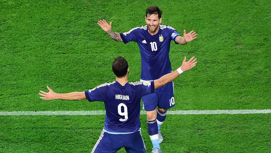 Argentina's Gonzalo Higuain (9) celebrates with teammate Lionel Messi after scoring against USA during their Copa America Centenario semifinal football match in Houston, Texas, United States, on June 21, 2016.  / AFP / Frederic J. BROWN        (Photo credit should read FREDERIC J. BROWN/AFP/Getty Images)