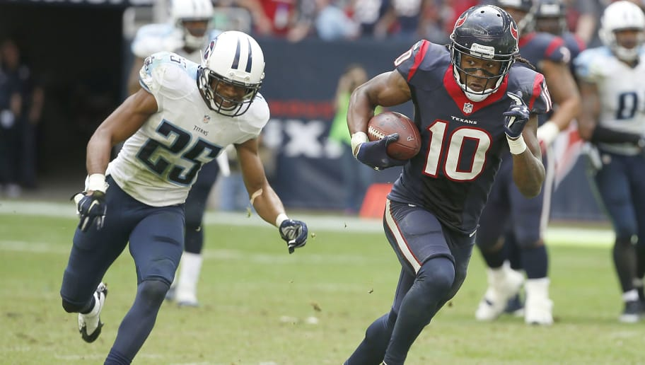 HOUSTON, TX - NOVEMBER 30: DeAndre Hopkins #10 of the Houston Texans runs after the catch while Blidi Wreh-Wilson #25 of the Tennessee Titans chases in the fourth quarter in a NFL game on November 30, 2014 at NRG Stadium in Houston, Texas. (Photo by Scott Halleran/Getty Images)