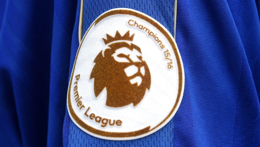LEICESTER, ENGLAND - MAY 07:  A Premier League Champions badge adorns a fan's shirt outside the stadium before the Barclays Premier League match between Leicester City and Everton at The King Power Stadium on May 7, 2016 in Leicester, United Kingdom.  (Photo by Michael Regan/Getty Images)