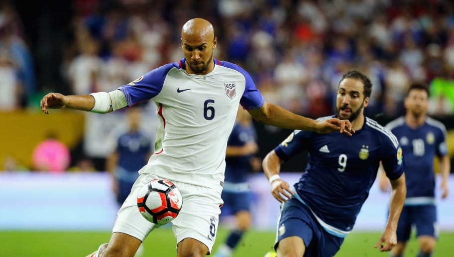 HOUSTON, TX - JUNE 21:  John Brooks #6 of United States handles the ball against Gonzalo Higuain #9 of Argentina in the second half during a 2016 Copa America Centenario Semifinal match at NRG Stadium on June 21, 2016 in Houston, Texas.  (Photo by Bob Levey/Getty Images)