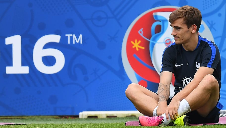 France's forward Antoine Griezmann stretches at the end of a training session in Clairefontaine en Yvelines on June 21, 2016, during the Euro 2016 football tournament.  / AFP / FRANCK FIFE        (Photo credit should read FRANCK FIFE/AFP/Getty Images)