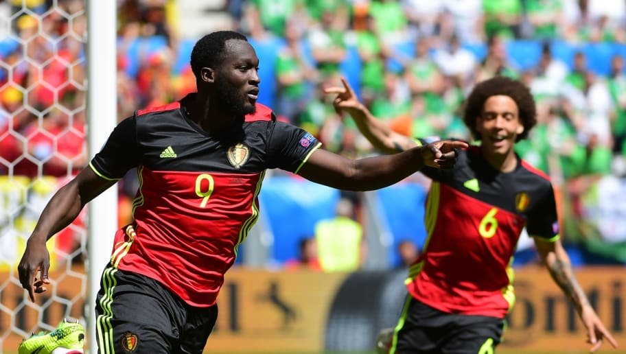 Belgium's forward Romelu Lukaku (L) celebrates after scoring a goal during the Euro 2016 group E football match between Belgium and Ireland at the Matmut Atlantique stadium in Bordeaux on June 18, 2016. / AFP / EMMANUEL DUNAND        (Photo credit should read EMMANUEL DUNAND/AFP/Getty Images)