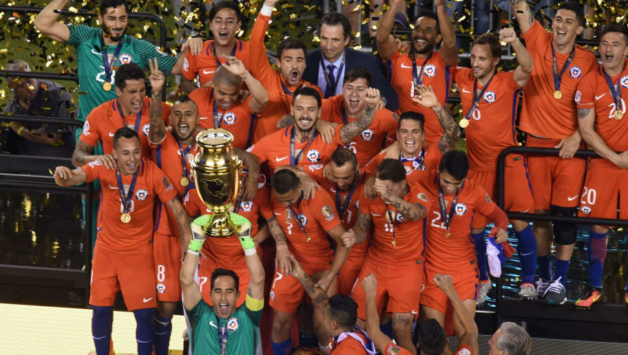 Chile's goalkeeper Claudio Bravo lifts the trophy after winning the Copa America Centenario final by defeating Argentina in the penalty shoot-out in East Rutherford, New Jersey, United States, on June 26, 2016.  / AFP / DON EMMERT        (Photo credit should read DON EMMERT/AFP/Getty Images)