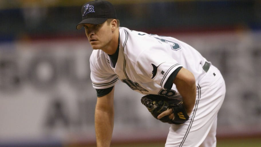 ST. PETERSBURG, FL - SEPTEMBER 17:  Pitcher Lance Carter #38 of the Tampa Bay Devil Rays prepares to throw during the game against the New York Yankes on September 17, 2002 at Tropicana Field in St. Petersburg, Florida.  The Devil Rays defeated the Yankees 9-7.  (Photo by Andy Lyons/Getty Images)