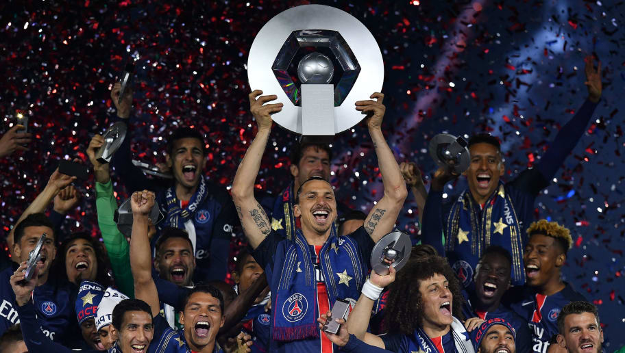 Paris Saint-Germain's Swedish forward Zlatan Ibrahimovic holds the trophy on the podium after winning the French L1 title at the end of the French L1 football match Paris Saint-Germain (PSG) vs Nantes on May 14, 2016 at the Parc des Princes stadium in Paris.   / AFP / FRANCK FIFE        (Photo credit should read FRANCK FIFE/AFP/Getty Images)