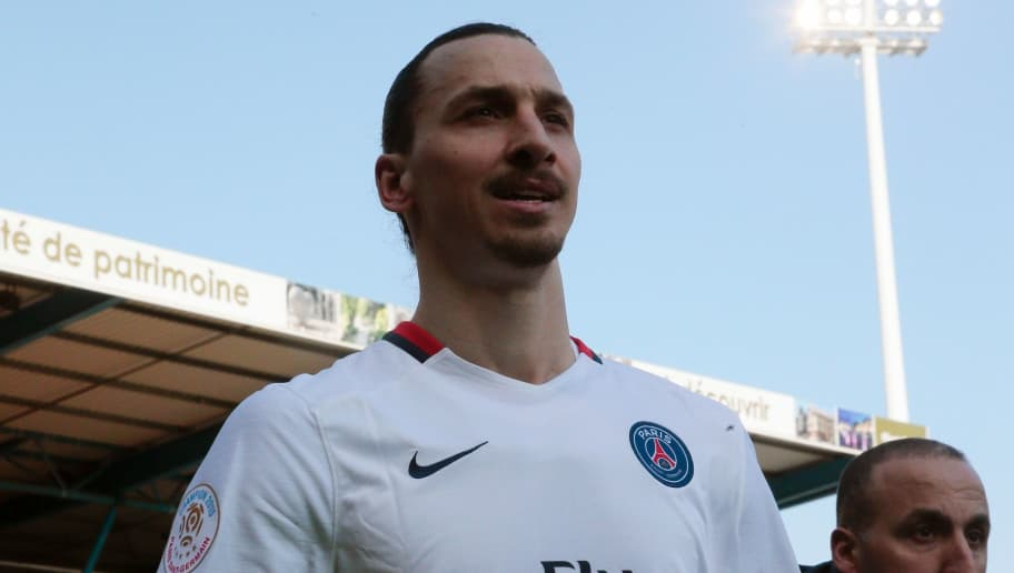 Swedish forward Zlatan Ibrahimovic celebrates after winning the French Ligue 1 football match against Troyes to clinch a fourth consecutive Ligue 1 crown on March 13, 2016 at the Aube Stadium in Troyes. Paris Saint-Germain clinched a fourth consecutive Ligue 1 title in record time on March 13 after defeating Troyes, obliterating a new French record for the quickest league victory with eight games to spare before the end of the L1 championships. / AFP / JACQUES DEMARTHON        (Photo credit should read JACQUES DEMARTHON/AFP/Getty Images)