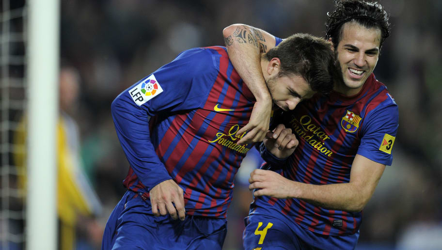 Barcelona s defender Gerard Pique (L) and Barcelona s forward Cesc Fabregas  (R) celebrate c67e8583345
